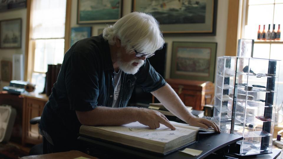 Paul Watson looking through log book