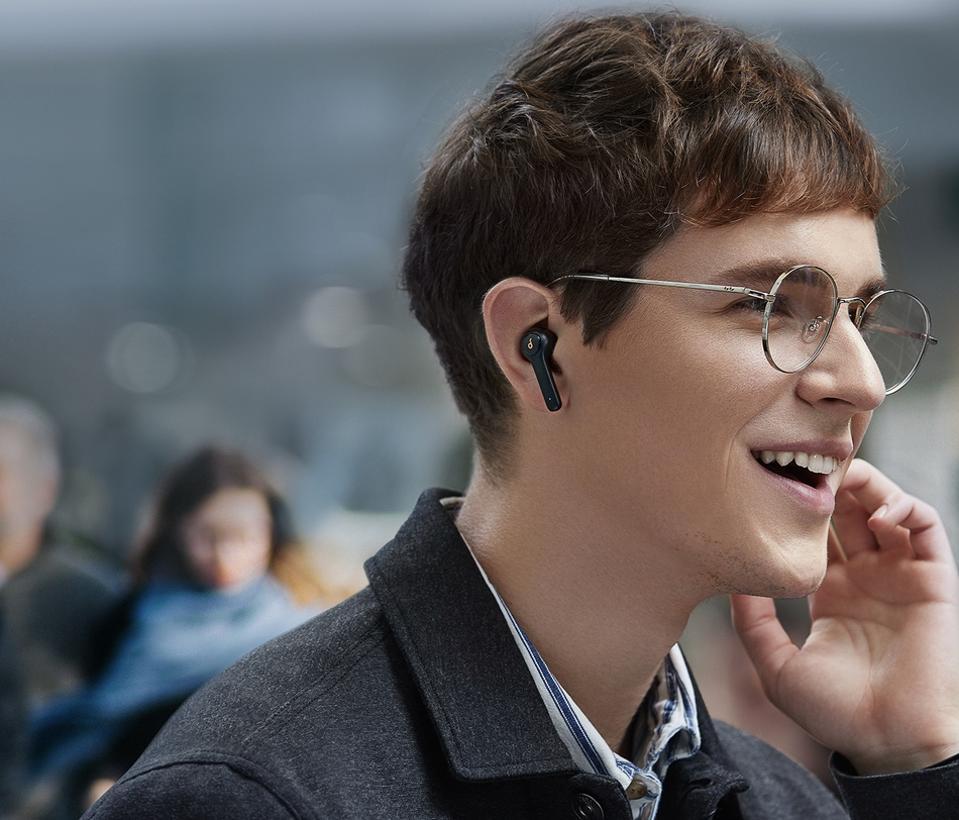 Man wearing Soundcore Life P2 true-wireless earphones.