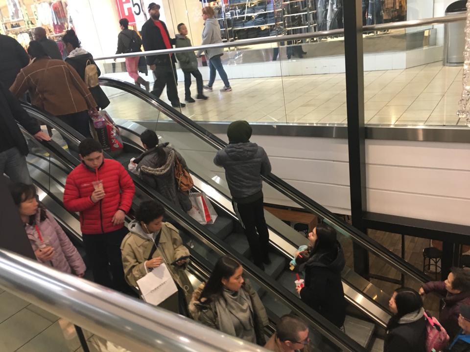 Shoppers on an escalator at Westfield Garden State Plaza on the last Saturday before Christmas, December 21, 2019.