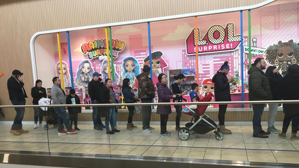 Shoppers standing in front of the Toys R Us store in Paramus, N.J. on the last Saturday before Christmas in 2019.
