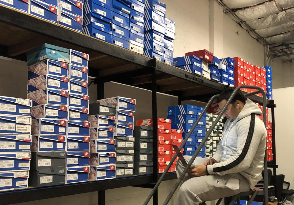 Footwear inventory inside Emma's Premium Services' warehouse in New Brunswick, New Jersey.