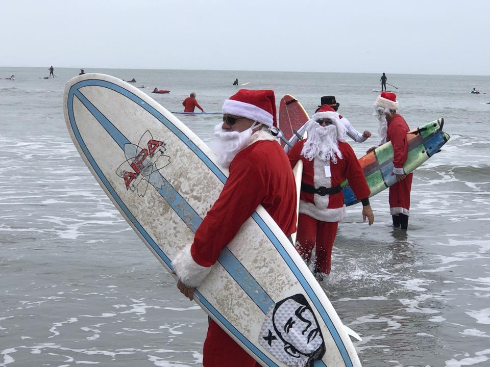 Surfing Santas at Cocoa Beach, Florida