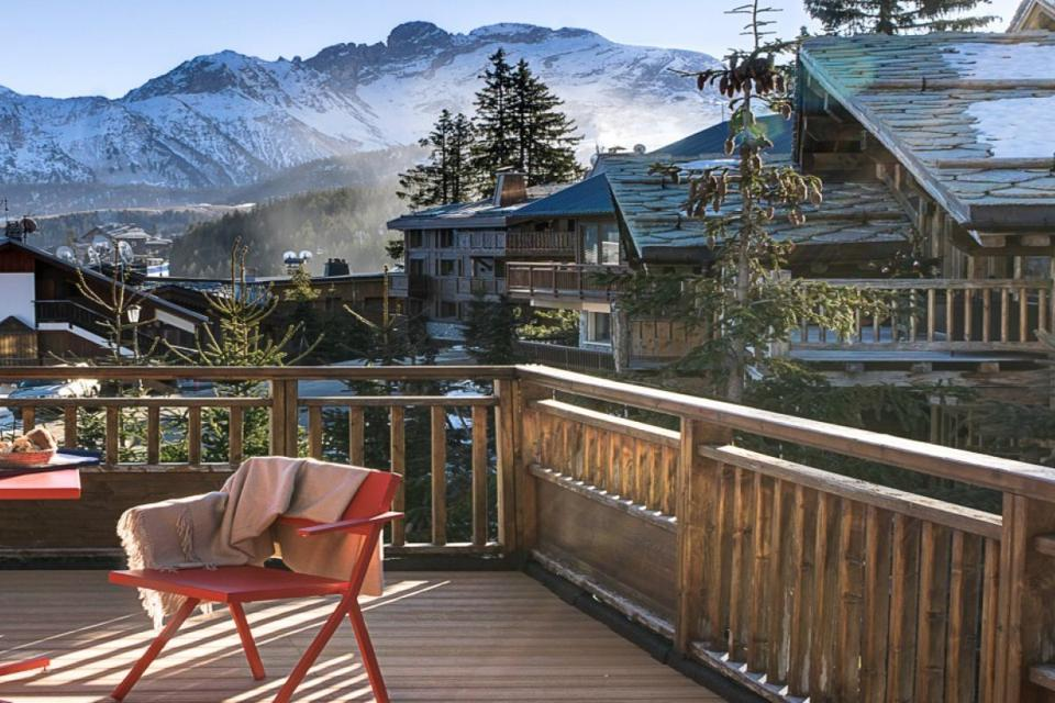 View of the French Alps from the wooden deck of La Sivolière Hotel.