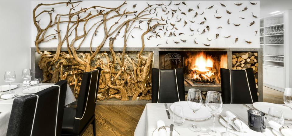 Fireplace at La Sivoliere restaurant in Courchevel, French Alps.
