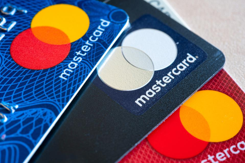 In this photo illustration there are three Mastercard Credit...