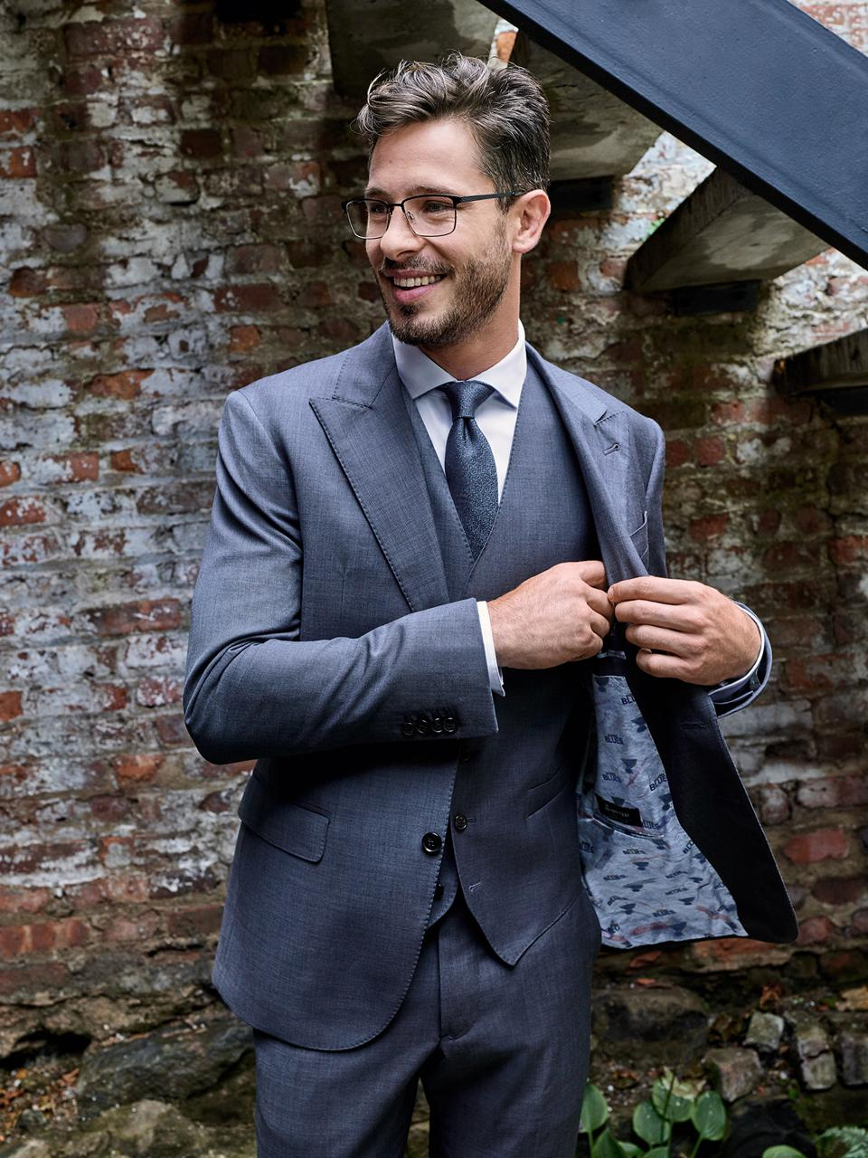 New Grooming: The importance of proper dress and fresh face in the rise to corporate ascension. Suit by Men's Wearhouse