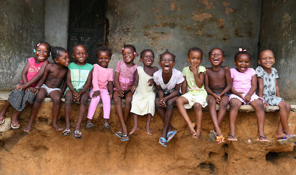 School children in Côte d'Ivoire, where a new classroom is being constructed out of recycled plastic bricks.