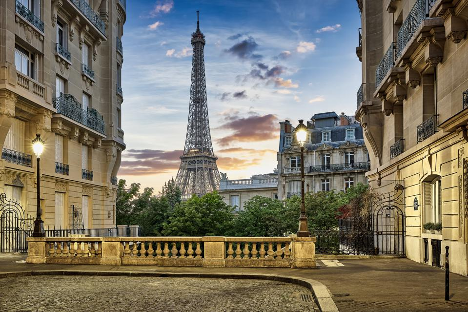 Eiffel Tower with Haussmann apartment Buildings in foreground, Paris, France