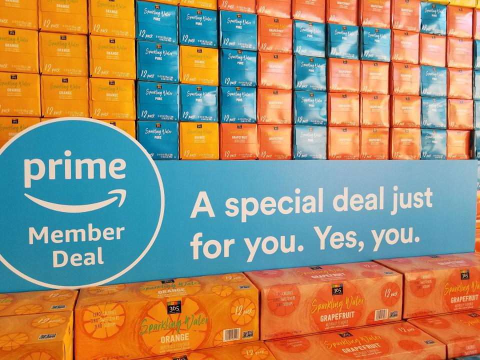 Whole Foods Market grocery store signage advertises new discounts for members of Amazon Prime. Amazon acquired Whole Foods Market in 2017, June, 2018.