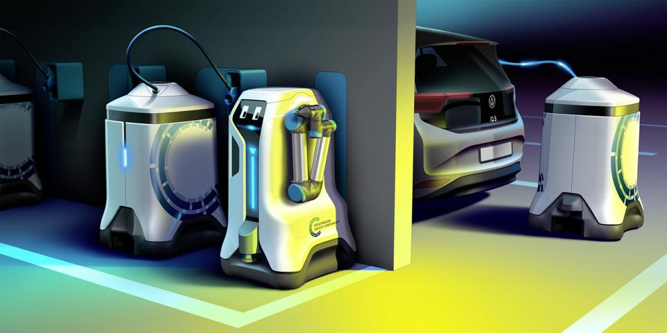 A Volkswagen EV being charged by a mobile battery.