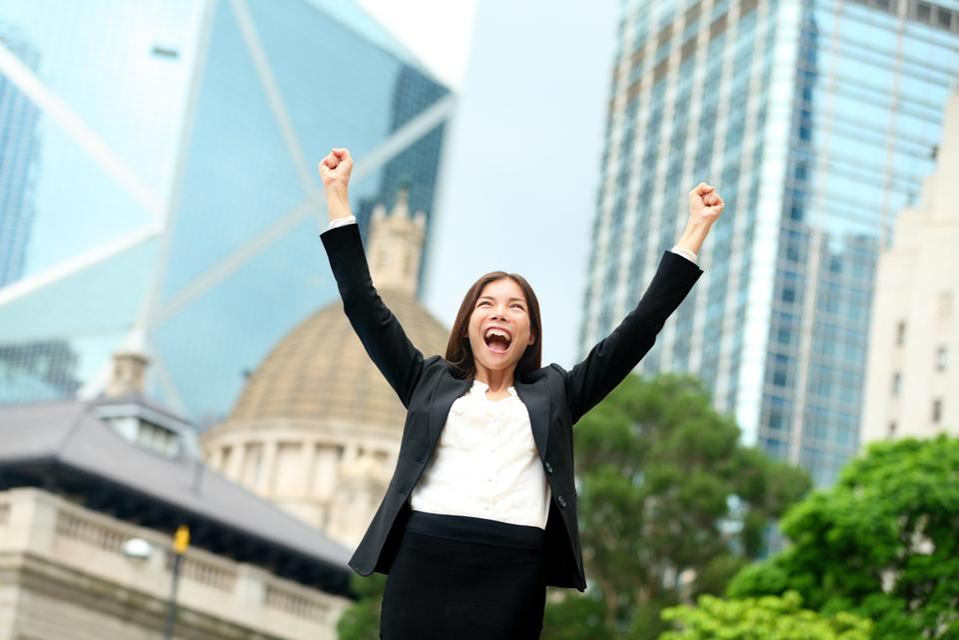 Woman celebrating reaching goals