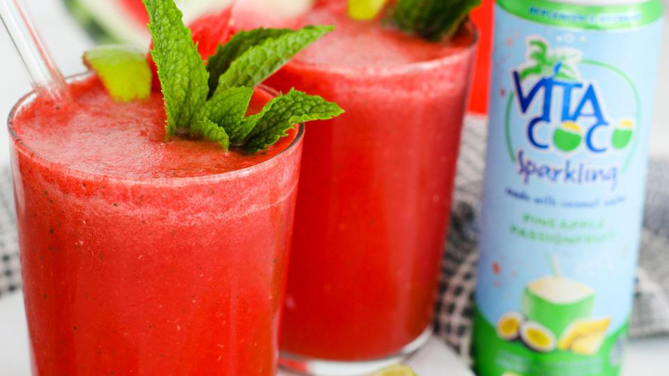A frozen watermelon drink, garnished with mint.