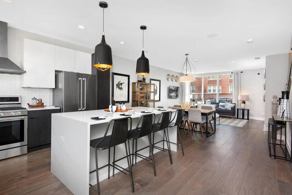 Black-and-white kitchen from model unit at Lexington Village at Avondale in Chicago.