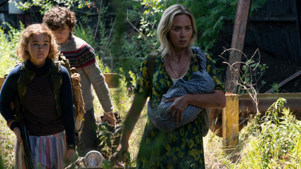 L-r, Regan (Millicent Simmonds), Marcus (Noah Jupe) and Evelyn (Emily Blunt) brave the unknown in ″A Quiet Place Part II.""