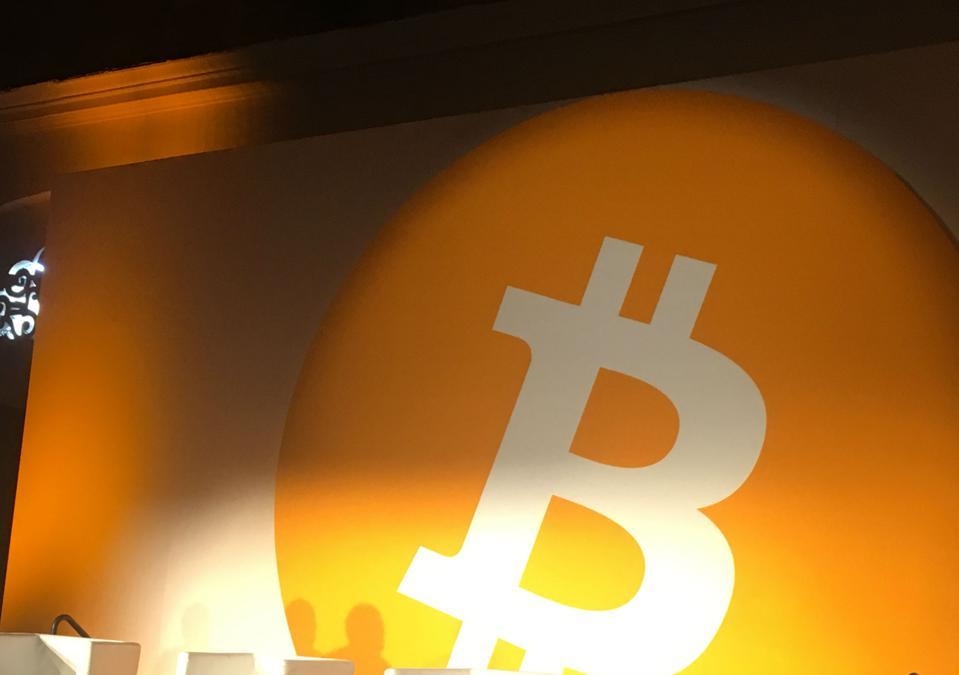 The Bitcoin symbol looms over Bitcoin Conference 2019.