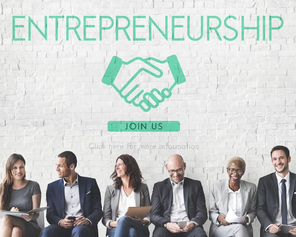 Happy entrepreneurs looking for other entrepreneurs.