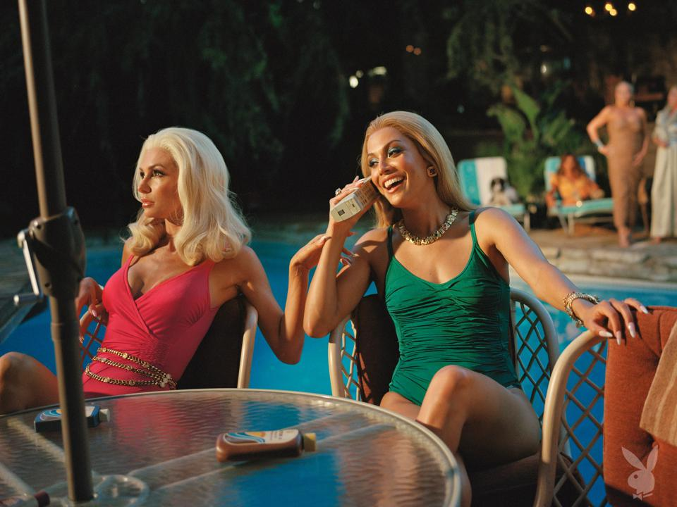 Two women lounge by a pool, one talking on an 80s era cell phone.