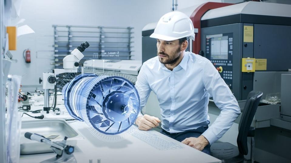 man looking at virtual technology
