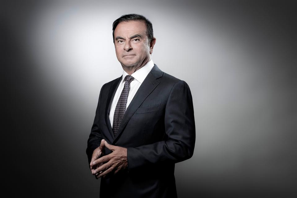 Carlos Ghosn poses during a photo session