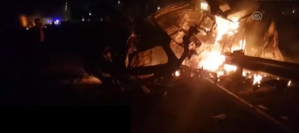 Flaming wreckage of convoy carrying Iranian Gen. Qasem Solemaini after U.S. drone strike.