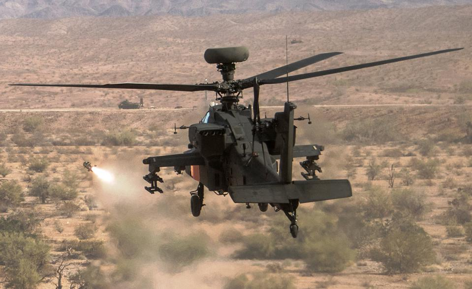 Apache attack helicopter tests JAGM missile at Yuma Proving Ground.