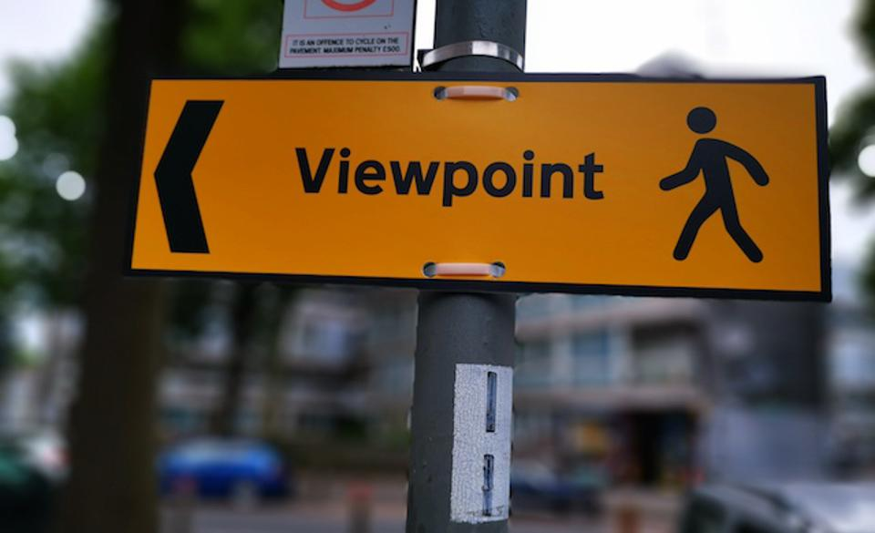 A sign that reads the word VIEWPOINT and an image of a man & woman. An arrow delivers.