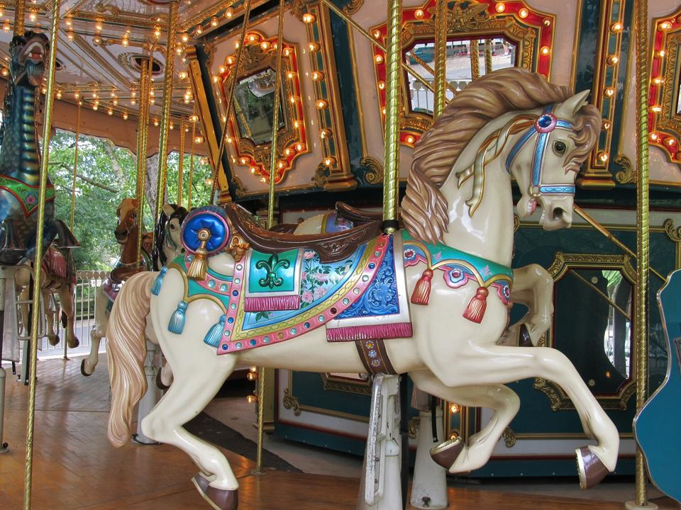 Wooden horse on merry-go-round.
