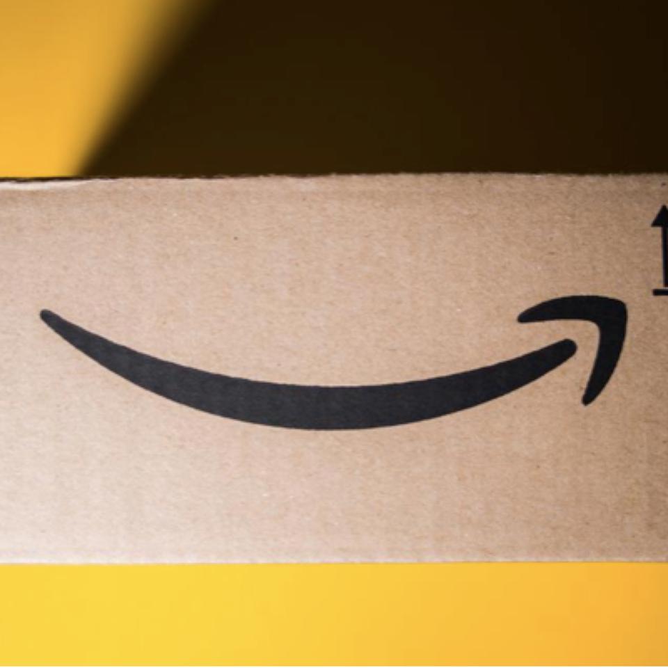 New Amazon Cardboard box against yellow background