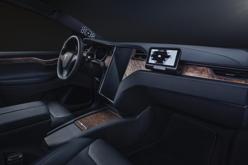 The interior of a Tesla Model X outfitted with Harman Ecotect electronics platform.
