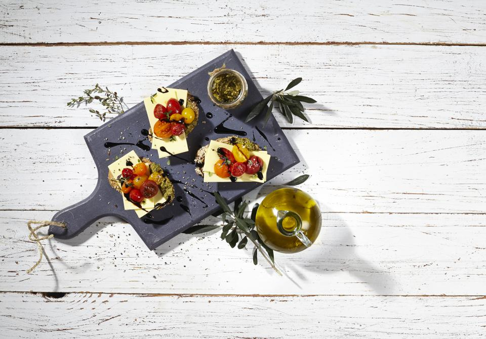 Bruschetta with Violife Smoked Provolone, one of many vegan cheese brands now on the market.
