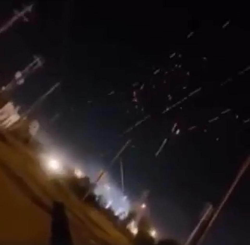 Tracers stitch across the night sky as U.S. air defensesshoot at incoming rockets in Iraq.