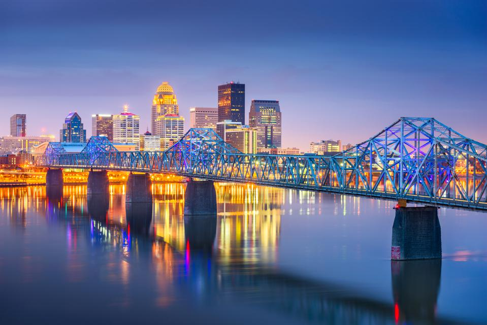 Louisville, Kentucky, USA downtown skyline on the Ohio River at dusk.
