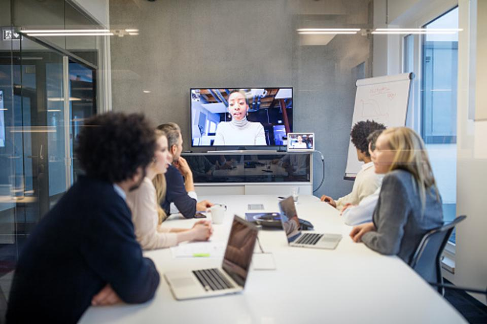 Employees sitting in a conference on video chat