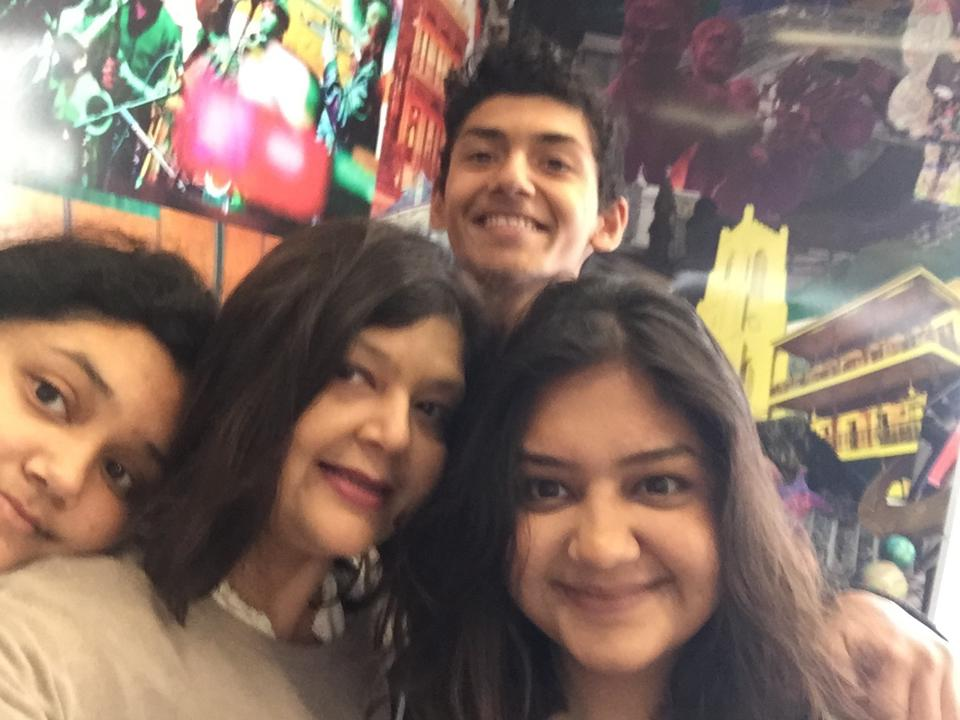 Qureshi poses in a selfie with her three children.