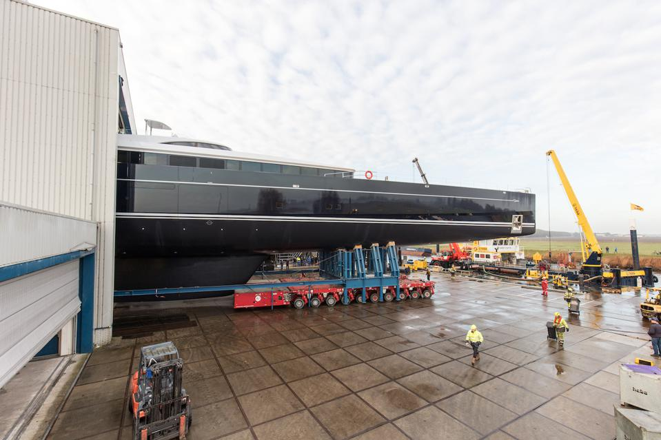 The first 130-feet of Sea Eagle II emerge from the shed.