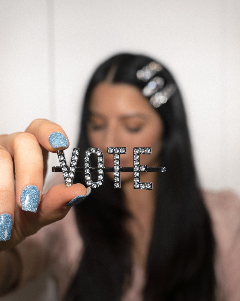 "Justine Marjan with the Kitsch x Justine ""VOTE"" Rhinestone Bobby Pin"