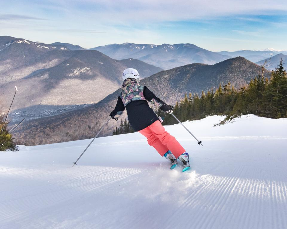 A lone skier carves a wide path at Loon Mountain Resort.