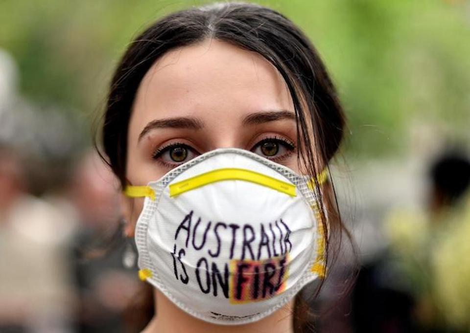 A demonstrator with a mask attends a climate protest rally in Sydney, Australia on December 11, 2019. Up to 20,000 protestors rallied to demand urgent climate action from Australia's government as smoke from the bush fires choked the city.