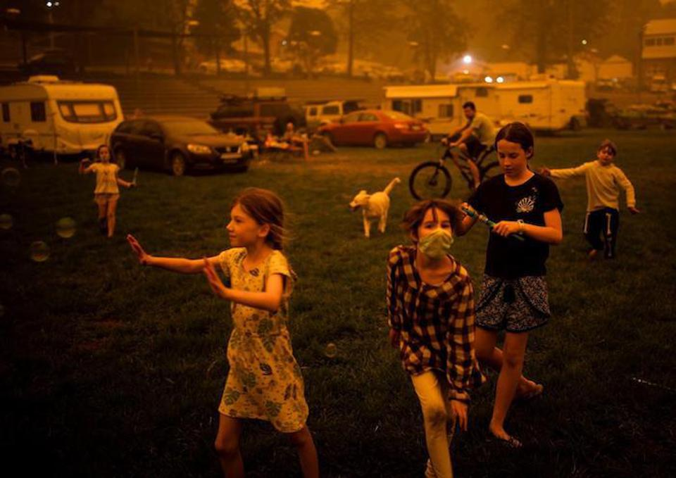 Children play at the showgrounds in the southern New South Wales town of Bega where they are camping after being evacuated from nearby sites affected by bush fires on December 31, 2019.