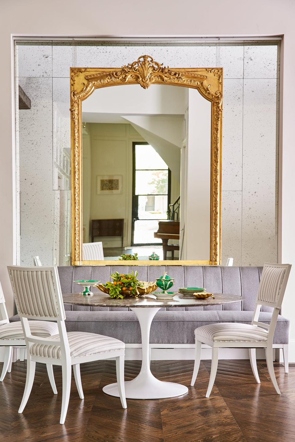 Bright dining room with mirrors