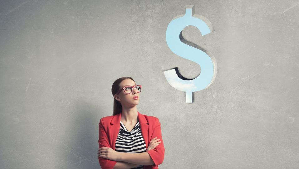 woman looking at dollar sign