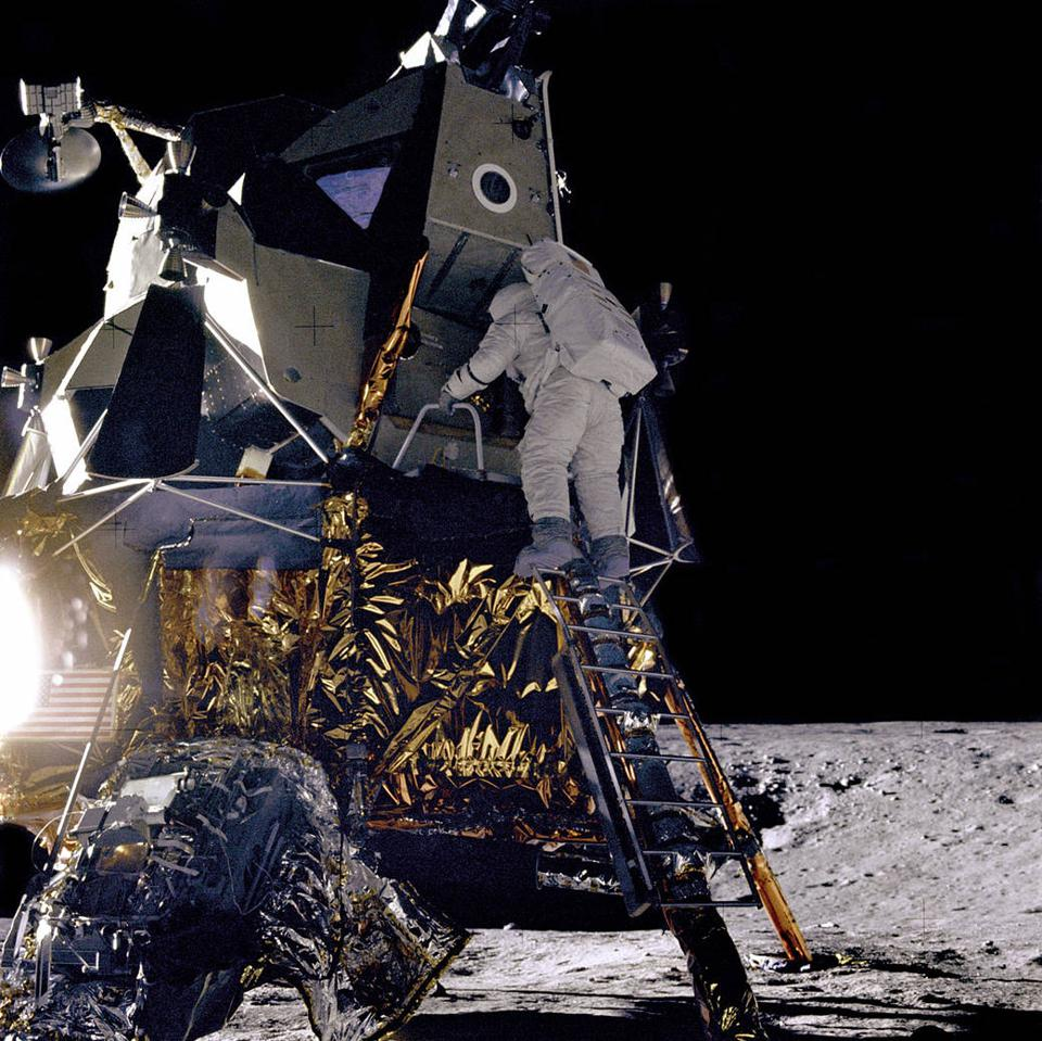 Apollo 12 astronaut Alan Bean climbs down the lander of his lunar lander, Intrepid.
