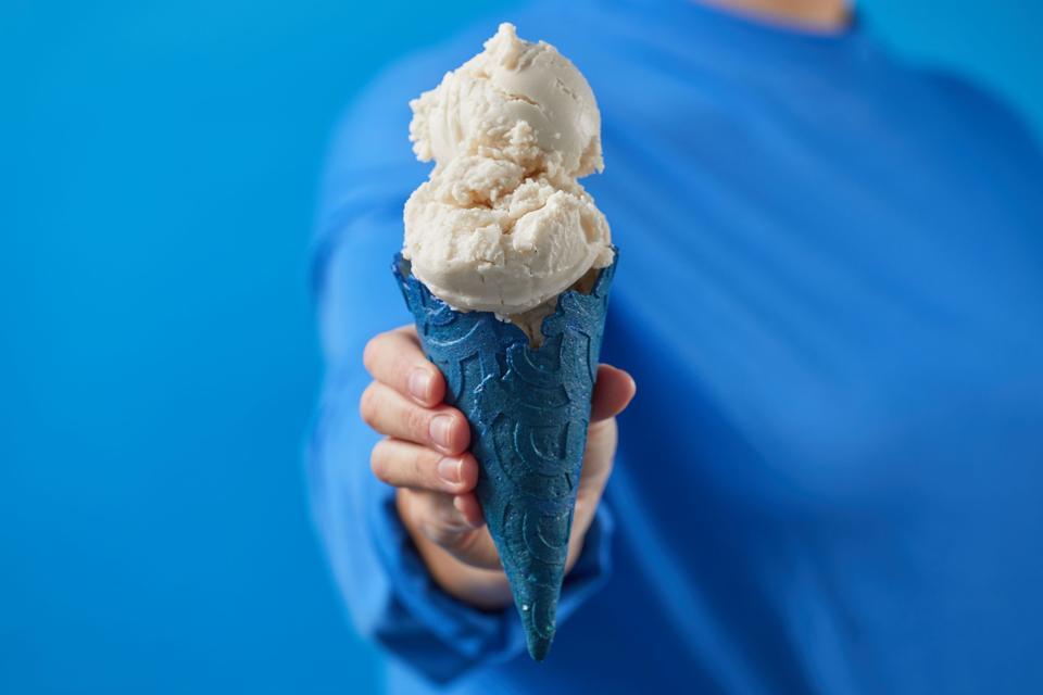 Eclipse ice cream in a vibrant cone.
