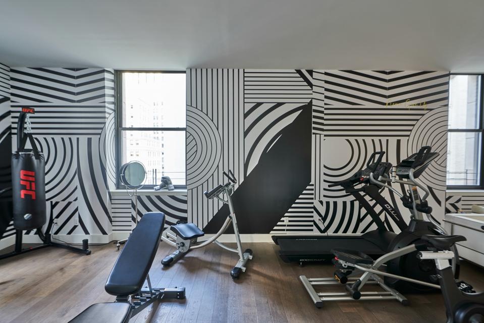 A room with gym equipment.
