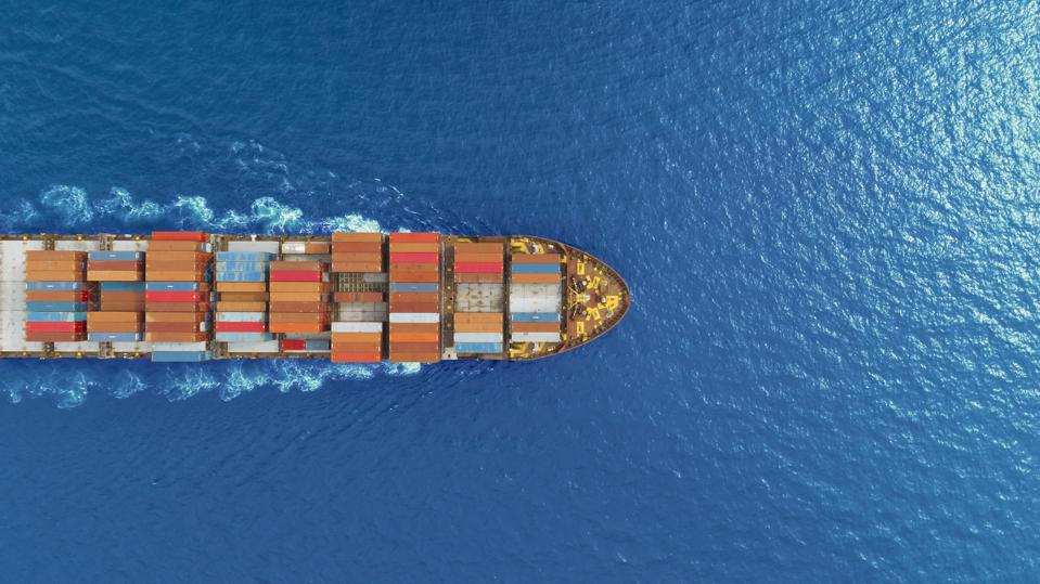 aerial top view container ship runing have wave in green sea, bangkok, thailand.