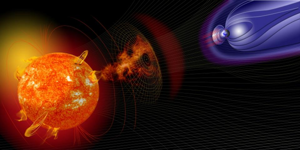 Artist's impression of a solar storm going towards Earth (at right).