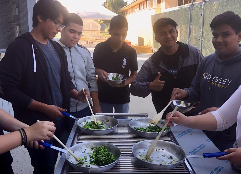 High school students learn to cook using the vegetables they grow in gardens on their school's property.