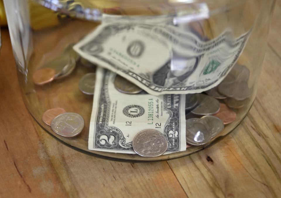 Money in a tip jar...