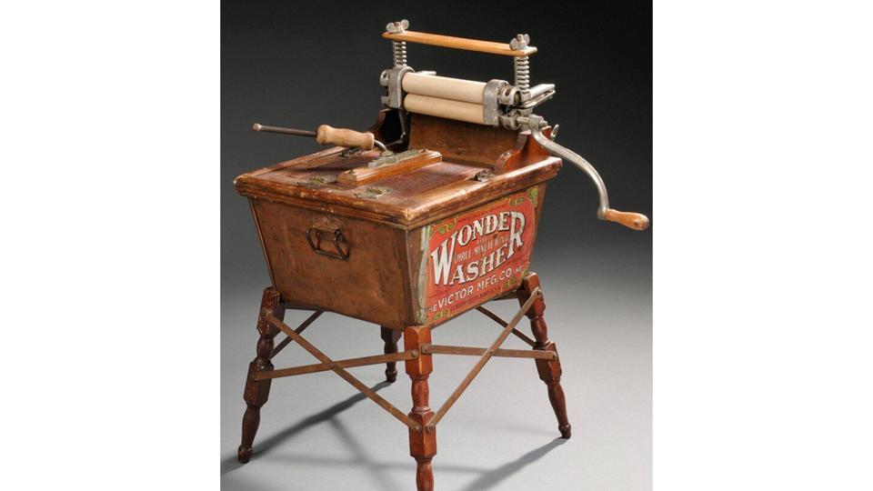 An American hand-cranked washing machine, circa 1900.