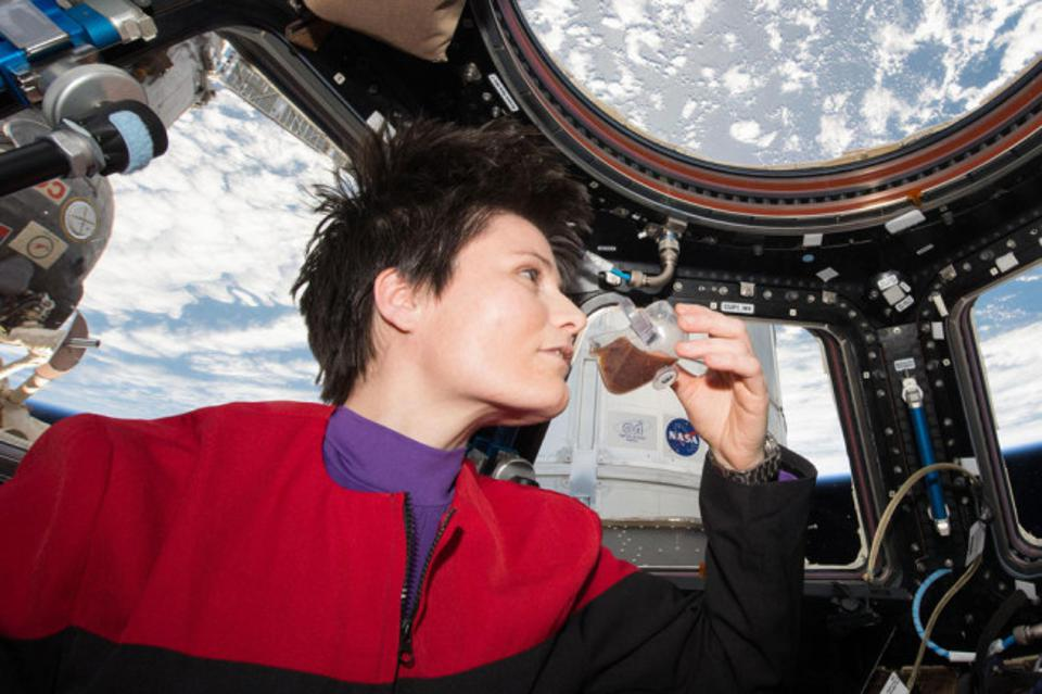 ESA astronaut Samantha Cristoforetti takes a sip of espresso from the zero-gravity cup.